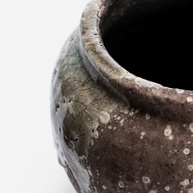 Small round rustic flowerpot