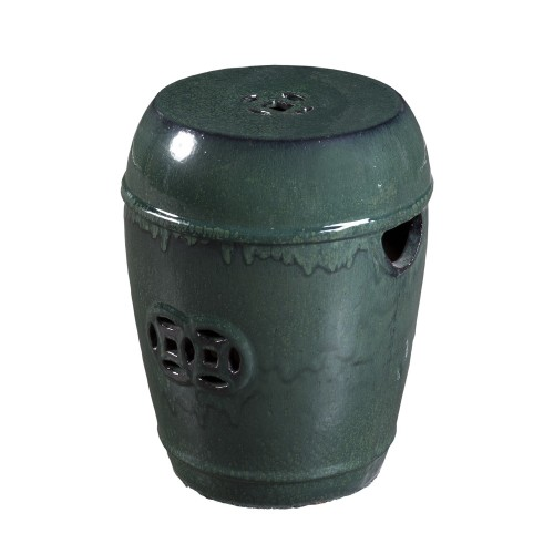 Green ceramic stool with holes