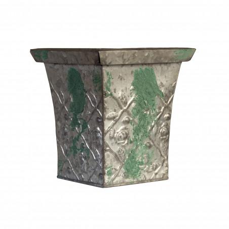 Macetero de metal verde desgastado