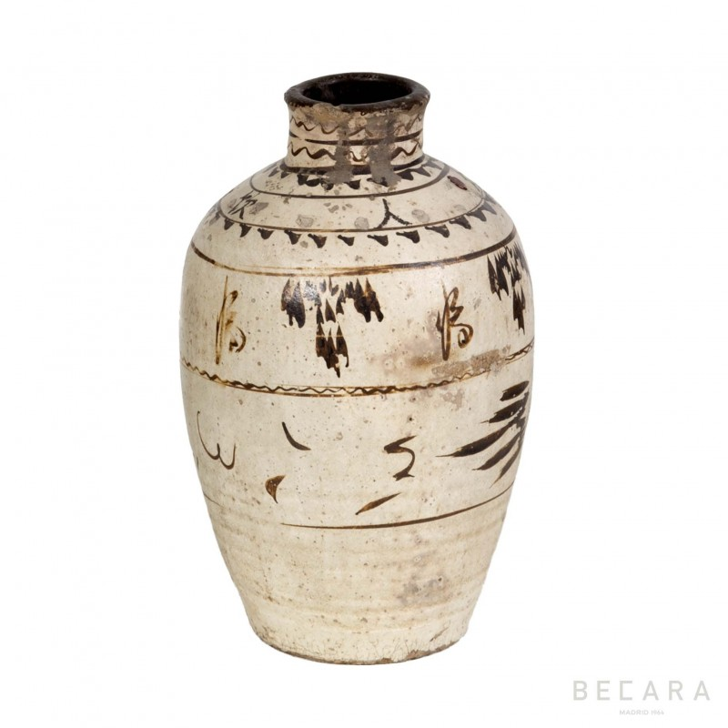 White and brown Antique jar