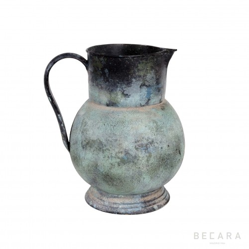 Green metal jug with tassel