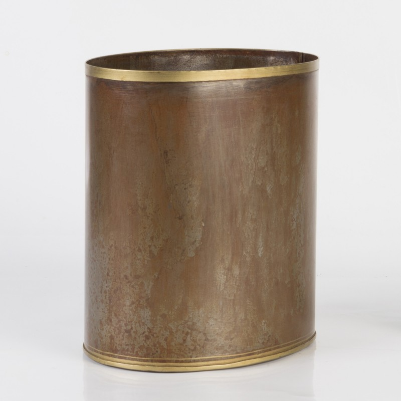 Rusty iron bucket with golden edges
