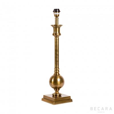 Goldish brass table lamp