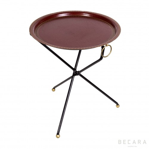 Red three-legged side table